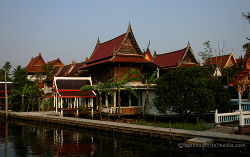buddhist temple beside a canal thailand